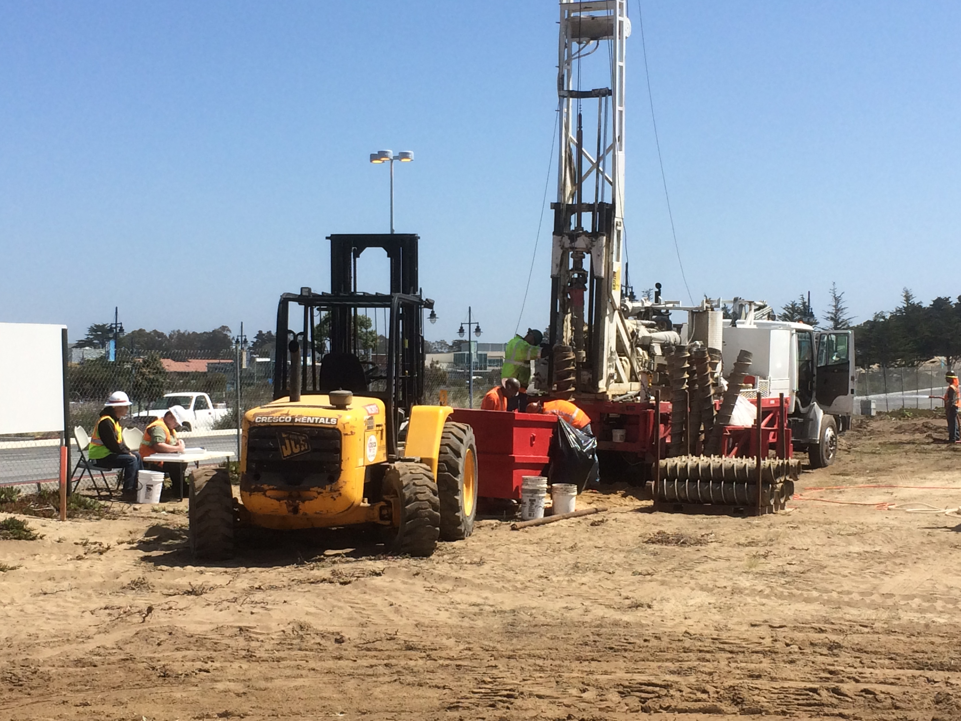 Drill rig at Dunes Shopping with geologists cateloging soils see CHOMP in background
